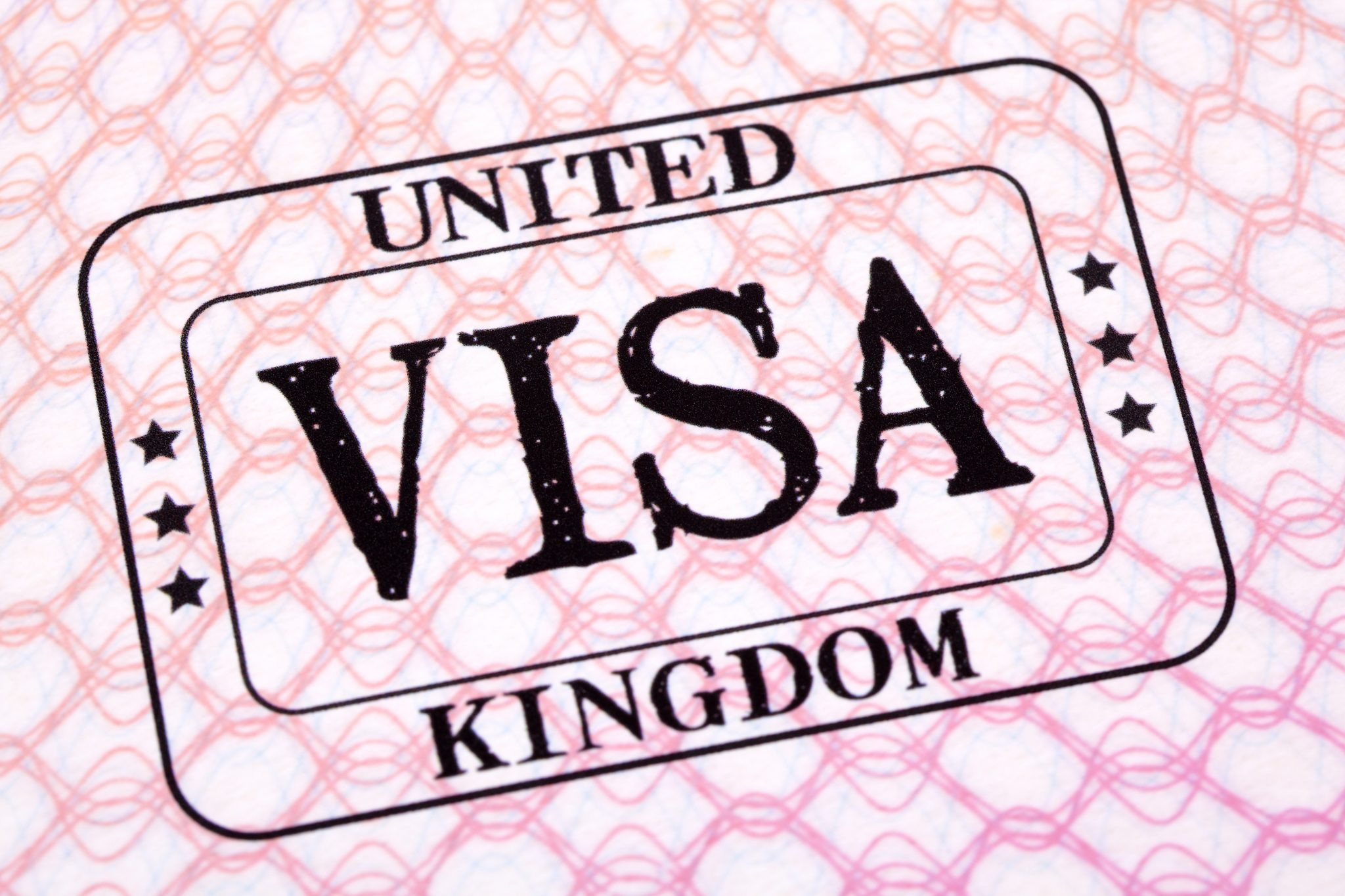UK visa immigration stamp passport page close up